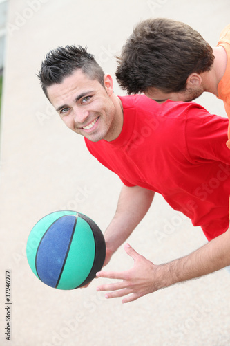 Young men playing handball