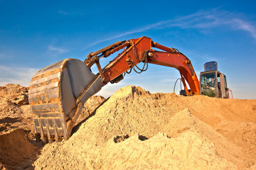 Excavator during earth moving works at sandpit
