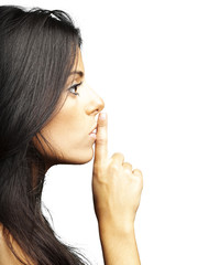 young woman with a silence gesture