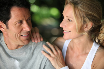 Mature fit couple exercising together in the countryside