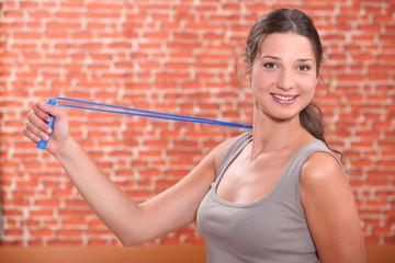 Woman using an arm extender