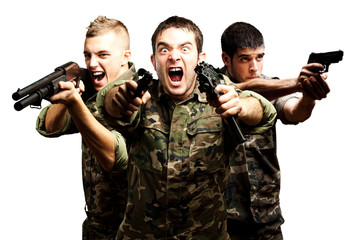 three soldiers aiming with their guns