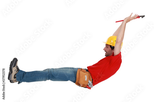 Tradesman jumping in the air