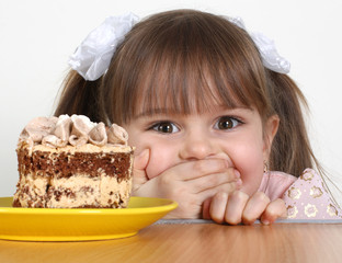 Child girl with cake