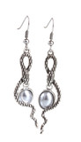 beautiful silver earrings with pearls isolated on white