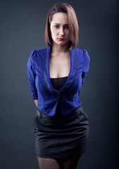 Busty woman in business clothes