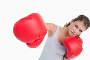 Serious woman boxing
