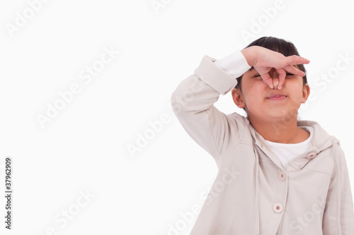 Girl pinching her nose