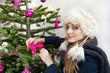 beautiful girl adorned Christmas tree