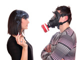 man with gas mask protects against tobacco smoke