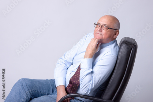 portrait of a successful senior man on gray background