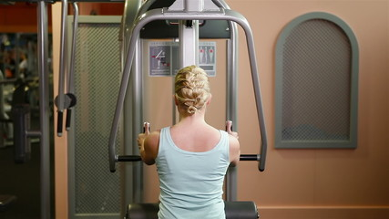 Woman doing workout in health club