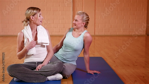 Two women talking in gym