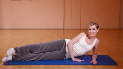 Woman stretching her legs in fitness center
