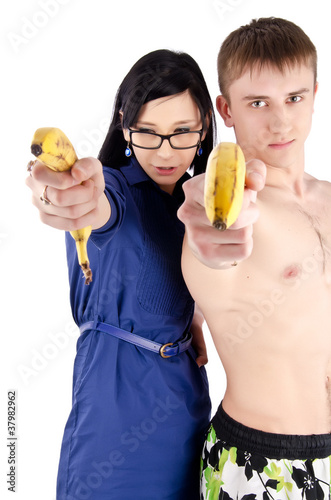 happy couple with banana on isolate background