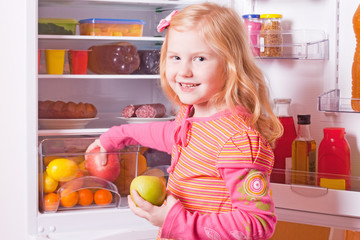girl with food on background refrigerator