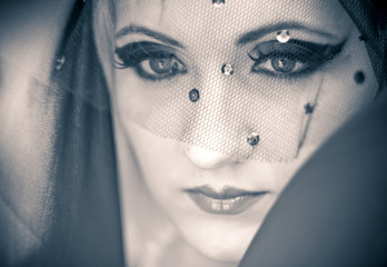 Beautiful retro blonde girl in veil