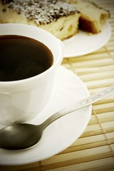 Coffee and cheesecake on bamboo mat