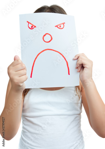 Child with a paper mask with an angry face isolated on white