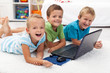 Happy kids with laptop computer