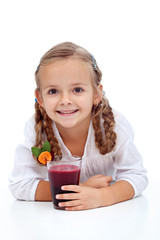 Happy smiling girl with fresh fruit juice