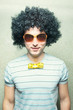 funny guy in afro curly wig with eyeglasses and bowtie