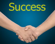 hand in Hand or handshake with the word Success