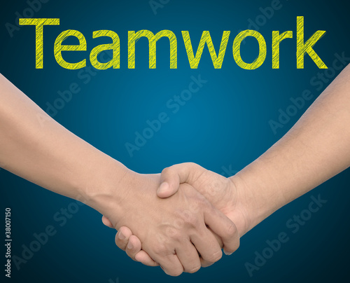 hand in Hand or handshake with the word Teamwork
