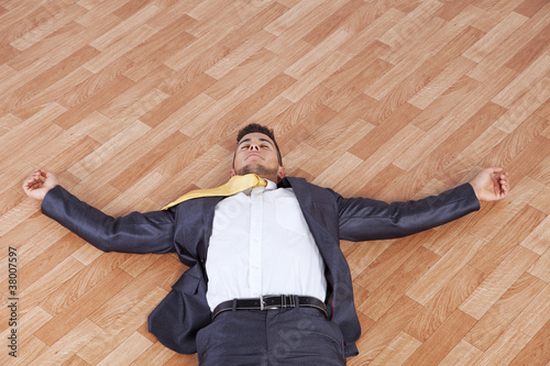 Businessman fainted on the office floor