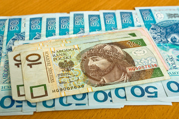 polish money - zloty, banknotes on the table