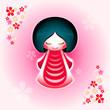 Spring japanese kokeshi doll with sakura flowers