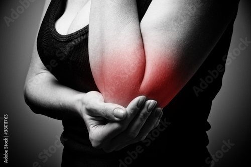 young woman having pain in her elbow
