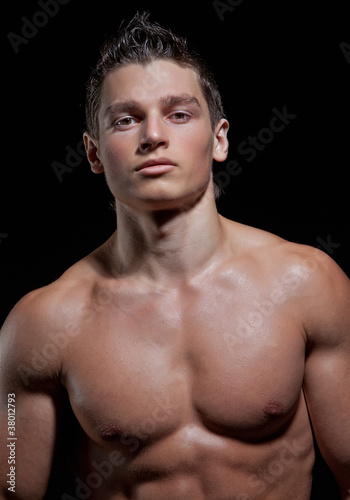 Chest-low portrait of the muscular young naked sexy boy