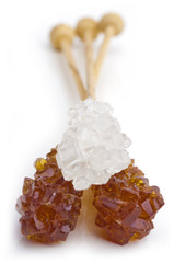 Candy brown and white sugar on a sticks.
