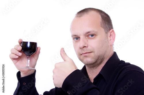 homme avec verre de vin rouge a la main et pouce lev oenologue de dreana photo libre de droits. Black Bedroom Furniture Sets. Home Design Ideas
