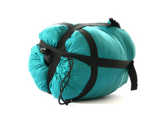 Packed sleeping-bag on white background