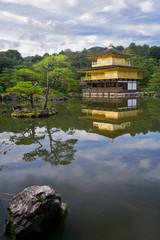 Golden temple near beautiful lake, Japan. Vertical image