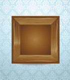 beautiful wooden frame on blue wallpaper