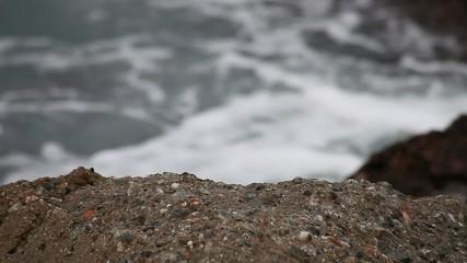 Waves between marine rocks