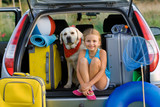 Fototapety Girl with dog ready for travel for summer vacation