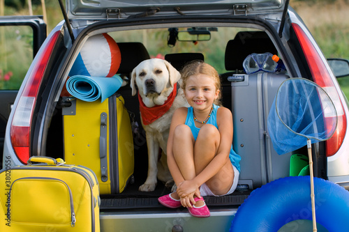 Leinwanddruck Bild Girl with dog ready for travel for summer vacation