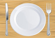 Plate and cutlery on wooden table