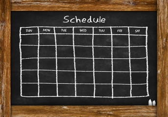 chalkboard with schedule and calendar