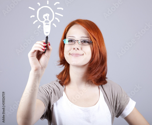 Young businesswomen with pen in hand