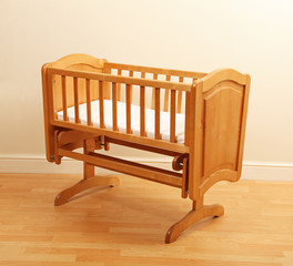 Empty wooden cot