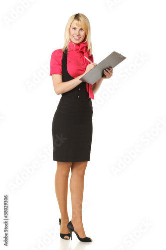 Full length of business woman making notes