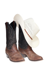 Cowboy boots and hat isolated over white with clipping path