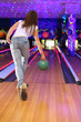 spin of girl wearing jeans making throw of green ball