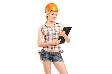 A female manual worker holding a clipboard