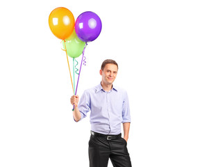 A person holding balloons